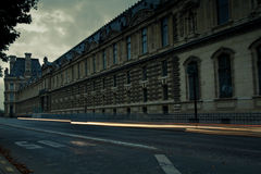 Light trail in front of The Louvre museum lit up at night. Royalty Free Stock Photo