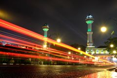 Light Trail, and Great Mosque Of Bandung`s Tower in the background. 1 April 2016, Bandung, Indonesia Royalty Free Stock Image