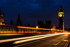 Light trail in the night at Big Ben Clock Tower, UK Royalty Free Stock Photography