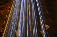 Light trail on the road with arrow. Its about a road with long exposure, create a light from car head lamp Stock Images