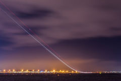 Light trail of starting plane Royalty Free Stock Images
