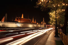 Light trail on street near Grand Palace temple Royalty Free Stock Photography