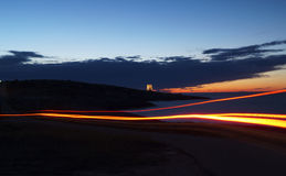 Light trail. S at dusk on a road near the shore royalty free stock photos