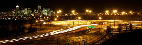 Light trails. Road and Hwy. system around down town by night Royalty Free Stock Photos