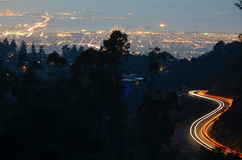 Light trails above San Francisco bay. Cars leave light trails as they ascend and descend Skyline Blvd. high above San Francisco bay Stock Photo