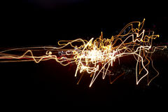 Light trails. Against dark background Stock Images