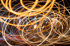 Light trails against dark background on road Royalty Free Stock Image