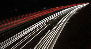Light trails of approaching cars at night. Approaching cars on suburban motorway at night time Stock Photography