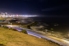 Light trails and beach at night Royalty Free Stock Photography