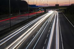 Light trails on the british motorway at night Stock Images