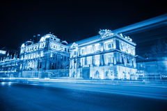 Light trails on the bund in shanghai. Light trails on the street at night in shanghai the bund with historical buildings background ,blue tone Royalty Free Stock Photography