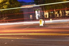 Light trails of buses and cars at night on a urban road in London, UK Stock Images