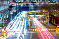 Light trails on the busy night streets, crossroad in big city Stock Photo