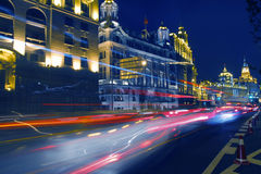 The light trails on the busy streets background Stock Photo