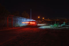 Light trails of car moving on the patrol road Royalty Free Stock Photos