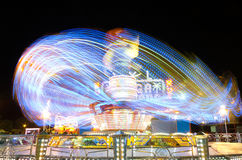 Light trails of a carrusel rotating Royalty Free Stock Photography