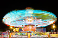 Light trails of a carrusel rotating Stock Photos