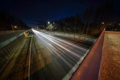 Light trails from cars on Kehä 1 at Helsinki captured at night with very wide angle lens and long exposure stock photos