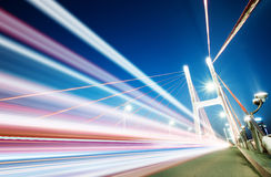 Light trails. Cars light trails on the modern bridge at dusk Royalty Free Stock Photo