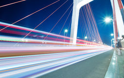 Light trails. Cars light trails on the modern bridge at dusk Royalty Free Stock Photos
