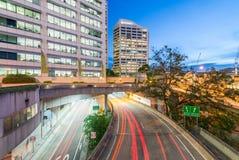 Light trails of cars speeding up along modern city Stock Photo
