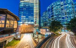Light trails of cars speeding up along modern city Royalty Free Stock Photography