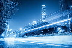 Light trails on city with blue tone Stock Images