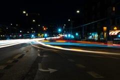 Light trails in the city centre of Copenhagen. Light trails, city lights and traffic lights in the Copenhagen streets at night. Taken at Oesterbrogade near Stock Image