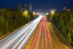 Light trails on city road stock image