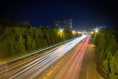 Light trails on city road stock photos