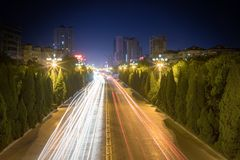 Light trails on city road royalty free stock photo