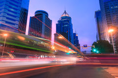 Light trails on a city street at dusk Royalty Free Stock Image