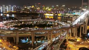 The light trails of city traffic on highway interchange at night,time lapse. stock footage