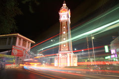 Light trails at clock tower in Nonthaburi Royalty Free Stock Image