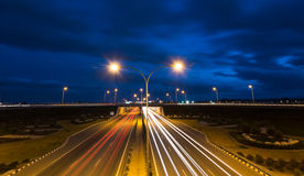Light trails from fast moving cars on a highway Stock Image