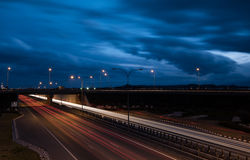 Light trails from fast moving cars on a highway Royalty Free Stock Photography