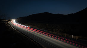 Light trails from fast moving cars Stock Photography