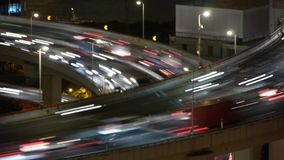 The light trails of fast moving cars on overpass,city traffic,time lapse. stock footage