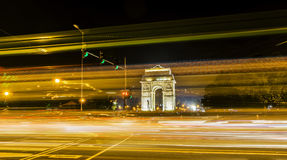 Light trails and Gateway of India in background. A wide angle long exposure shot of India Gate (formerly known as the All India War Memorial) with light trails Royalty Free Stock Photos
