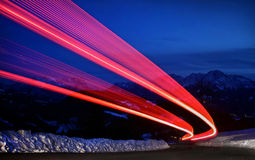 Light trails on a highway. LED taillights of a car driving on a highway royalty free stock image