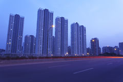 Light trails on the highway. Highway at night, surrounded by high-rise towers, beautiful light traces left behind when the car is moving stock image