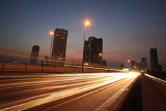 Light trails on the highway at dusk stock photography