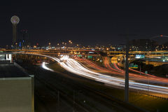Light trails on highway I-35 in Dallas with Reunion Tower. Long exposure night photograph of light trails on highway I-35 in Dallas taken from a parking garage Royalty Free Stock Photo