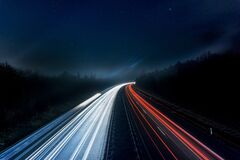 Light Trails on Highway at Night Stock Photography