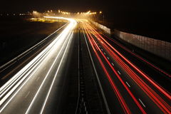 Light trails on highway. Road Stock Photo