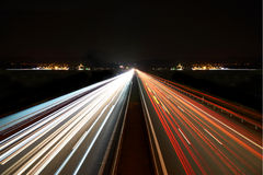 Light trails on highway symmetrical Royalty Free Stock Images