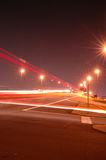 Light trails. Highway traffic on lit bridge at night royalty free stock images
