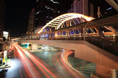 Light trails on Intersection under public sky walk Royalty Free Stock Photo