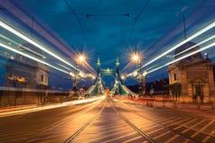 Light trails on Liberty bridge stock images