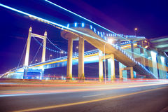 Light trails on the modern bridge Stock Photography